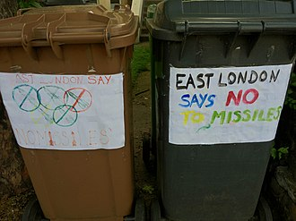 Security for the 2012 Summer Olympics - Wheeled bin posters against the plans to install missiles during the games
