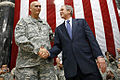 President G.W. Bush and Gen. Ray Odierno shake hands after speech (Al Faw Palace, Camp Victory Baghdad 14 Dec 2008).jpg