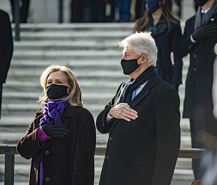 Clinton and her husband attend a wreath laying ceremony at the Tomb of the Unknown Soldier in Arlington National Cemetery after the inauguration of Joe Biden