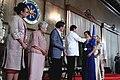 President Rodrigo Duterte awards a medal to Rujealyn Cancino, an outstanding teacher awardee.jpg