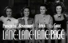 Description de l'image Priscilla, Rosemary and Lola Lane with Gale Page in Four Wives trailer.jpg.