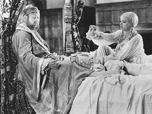 The Private Life of Henry VIII - King Henry VIII (Charles Laughton) and Anne of Cleves (Elsa Lanchester) on their wedding night in The Private Life of Henry VIII