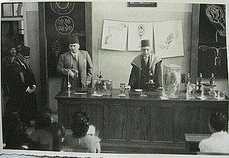 Naguib Pasha Mahfouz - Professor Mahfouz lecturing, with King Farouk in attendance