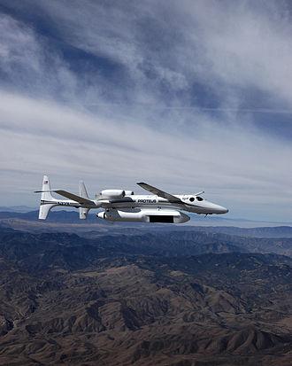 Scaled Composites Proteus - Proteus flies over the Tehachapi Mountains with the MP-RTIP radar pod