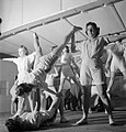 Pts For Lunch- Physical Training in the Canteen of a Southern Small Arms Factory, England, 1943 D13003.jpg