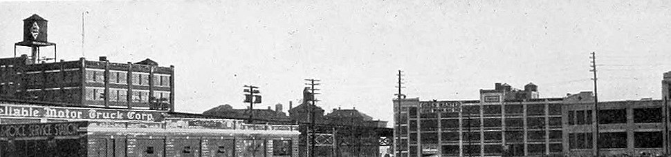 """Looking south from the Queensboro Bridge in Long Island City, this photo was published in 1920 by the Queens Chamber of Commerce to illustrate the borough's """"numerous attractive industrial plants""""."""