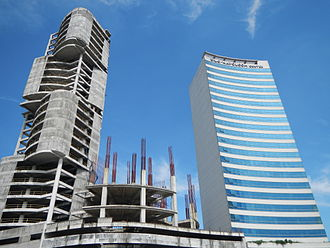 Department of the Interior and Local Government - The DILG Building (right) beside the yet to be completed The Skysuites Tower (left), Quezon Avenue, EDSA