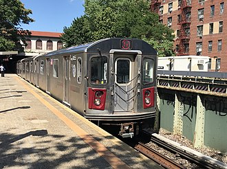 5 (New York City Subway service) - Image: R142 5 train approaches Morris Park
