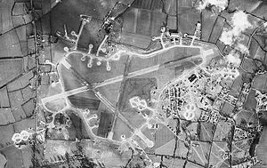 RAF Little Staughton -  Aerial photograph of Little Staughton airfield looking north, the technical site and barrack sites are to the right, 10 February 1944.