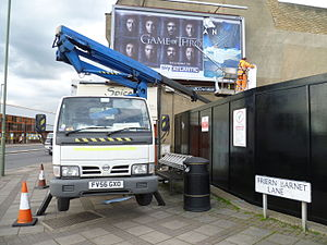 Aerial work platform - Replacing an advertising poster in London using an aerial work platform.