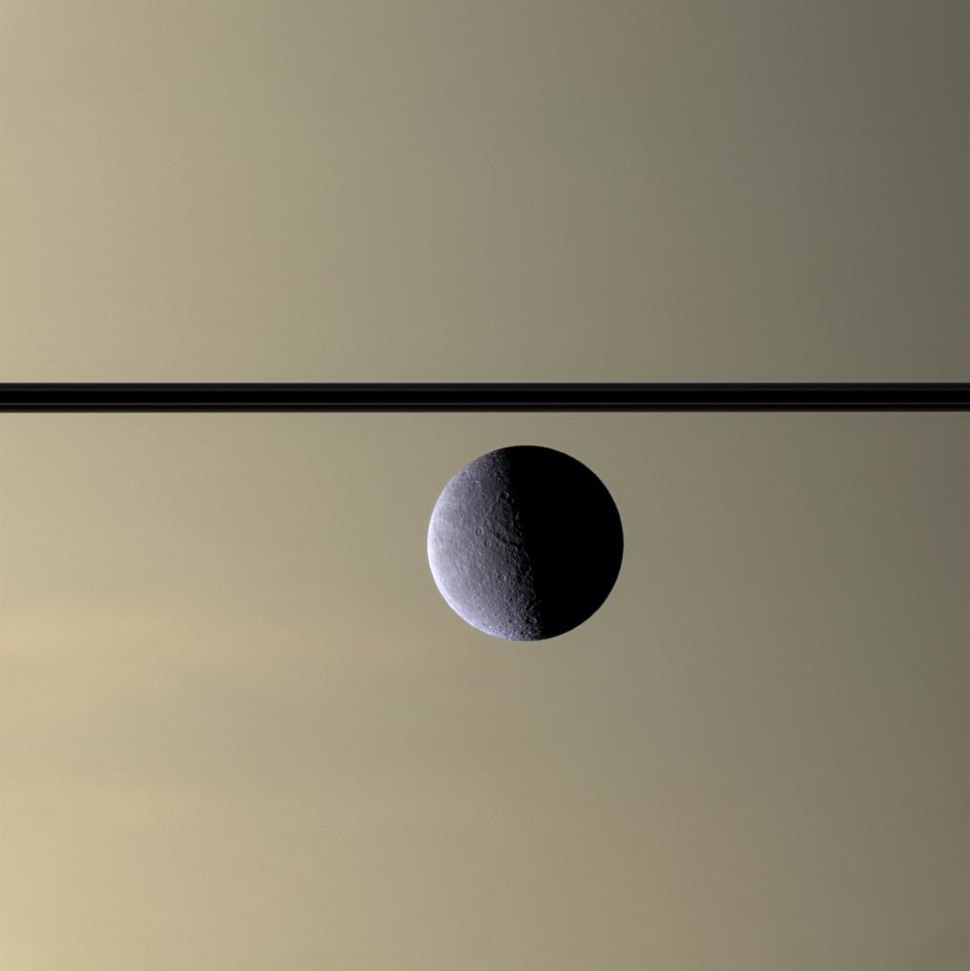 Rhea in front of Saturn