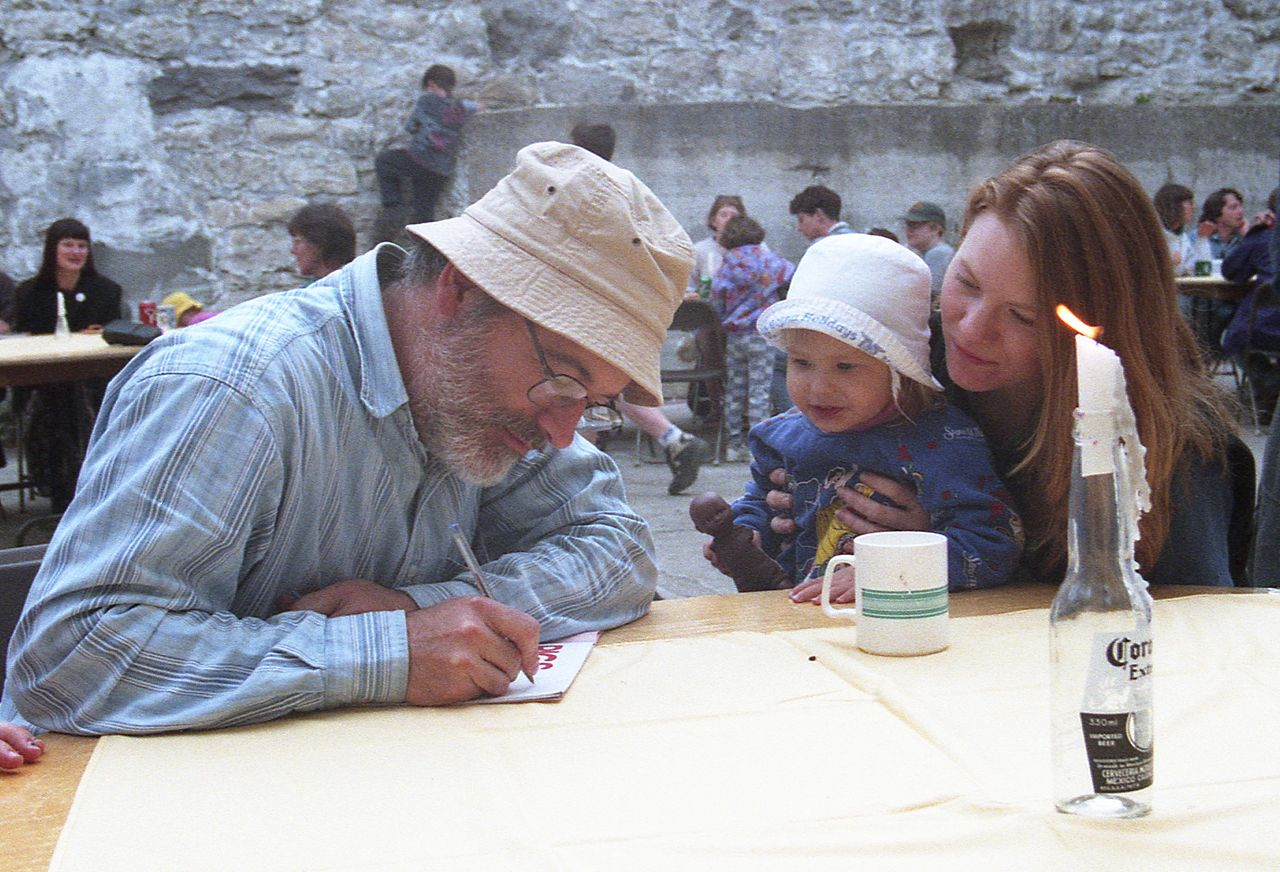 Munsch signs autograph for a young fan at Guelph, Ontario, Canada in 1997