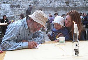 Robert Munsch - Munsch signs autograph for a young fan at Guelph, Ontario, Canada in 1997