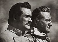 Rock Hudson-John Wayne in The Undefeated.jpg