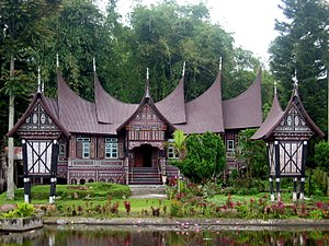 Rumah Gadang - Rumah gadang in the Pandai Sikek village of West Sumatra, with two rice barns (rangkiang) in front