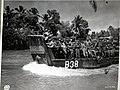 SC 207688 Landing craft carrying 24th Infantry Division troops up Mindanao River for Fort Pikit attack April 1945.jpg