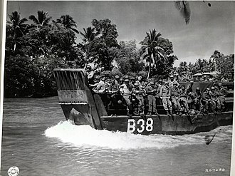 Battle of Mindanao - Image: SC 207688 Landing craft carrying 24th Infantry Division troops up Mindanao River for Fort Pikit attack April 1945