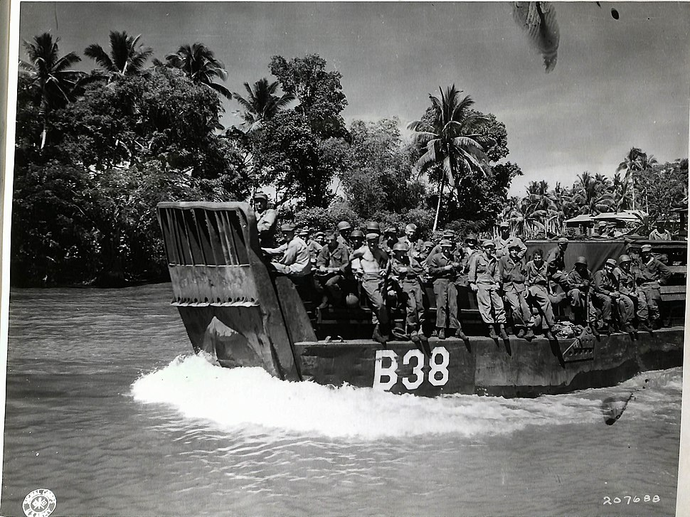 SC 207688 Landing craft carrying 24th Infantry Division troops up Mindanao River for Fort Pikit attack April 1945