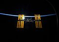 STS-119 International Space Station after undocking with earth atmosphere backdrop.jpg