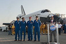 Amongst the aftermath of the landing, the crew of STS-135 stand alongside NASA Administrator Charles F. Bolden, Jr. as he makes a speech. Image: NASA / Kim Shiflett.