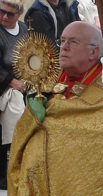 Benediction of the Blessed Sacrament - Cardinal Godfried Danneels vested in a humeral veil, holding a monstrance containing the Blessed Sacrament.