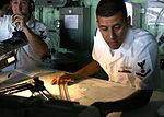 Sailor Plots course aboard USS San Antonio DVIDS117283.jpg