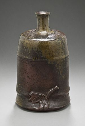 "Ash glaze - Sake Bottle (tokkuri) in the Form of a Bamboo Node, with ""naturally occurring"" ash glaze, most heavily collected on the shoulder. Japan, 18th century"