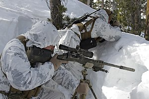 M40 rifle - Snipers utilize a M40A5 with tripod and suppressor while training at the Mountain Warfare Training Center
