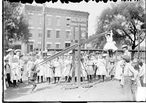 Seesaw - Girl hanging from a seesaw, Chicago, Illinois, 1902
