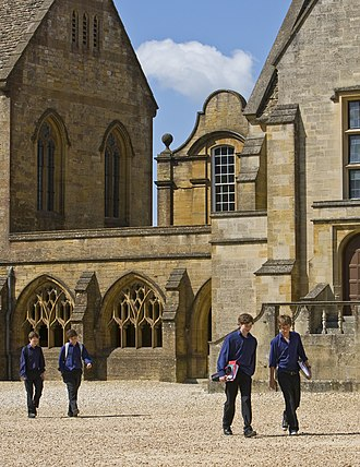 Sherborne School - Sherborne boys in Blues walking across the Courts to classes