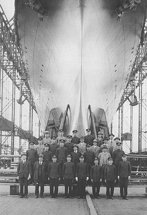 Japanese aircraft carrier Shōkaku - The twenty-eight chief shipbuilders of Shōkaku pose at the ship's prow prior to launching (30 May 1939).