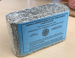 Shredded and briquetted US dollar notes from the Federal Reserve Bank of New York (approx. 1000 pieces, 1 kg)