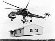 Sikorsky Skycrane carrying house bw