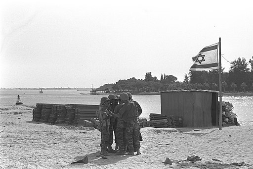 Six Day War. An Israeli troop carrier on the east bank of the Suez Canal opposite Ismailia. June 1967. D326-110