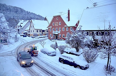 Snow causing bad road conditions Snowy road in Tieringen, Baden-Wurttemberg.jpg