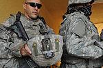 Soldiers, Iraqi national policemen distribute school supplies in Baghdad DVIDS157224.jpg