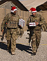 Soldiers in Afghanistan Carrying uk4u Thanks! Christmas Boxes MOD 45154776.jpg