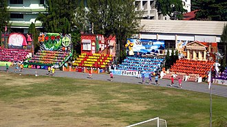 Triam Udom Suksa School - Sports day events include track events and audience performances.
