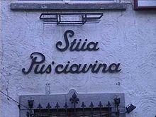 L'insegna di un ristorante scritta in schietto poschiavino a Poschiavo nei Grigioni