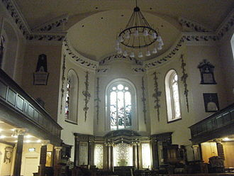 St. Ann's Church, Dawson Street - The apse, with two loaves of bread resting on the Bread Shelf to the left of the altar