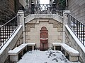 Stairs and drinking well. Winter. - Ponty Street & Szalag Street cnr, Budapest.JPG