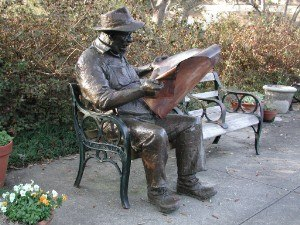 News media - Reading the newspaper: Brookgreen Gardens in Pawleys Island, South Carolina.
