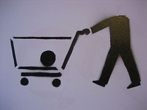 Stencil of a shopping cart with the head of th...