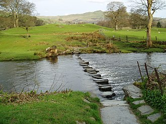 Footbridge - Stepping stones, across the River Rothay, in the Lake District, England