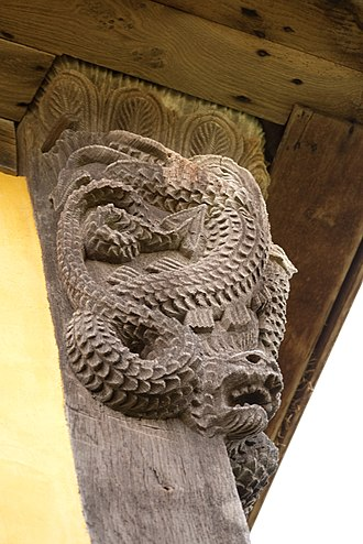 Serpents in the Bible - A 17th-century carved depiction of serpent in the Book of Genesis, at Stokesay Castle