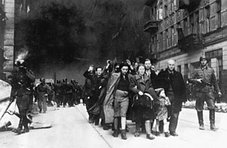 Warsaw Ghetto Uprising - Captured Jews are led by German troops to the assembly point for deportation. Picture taken at Nowolipie street, near the intersection with Smocza.