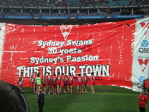 Sydney Swans - Sydney Swans players run through the banner before the inaugural Sydney Derby on 24 March 2012.