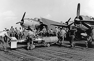 Mark 13 torpedo - A Mark 13B torpedo being loaded onto a Grumman TBF Avenger aboard the ''Wasp'' in 1944; the torpedo is fitted with wooden breakaway nose and tail protection which is shed upon hitting the water