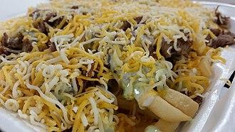 Carne asada fries - Image: Tacos El Gordo Carne Asada Fries close up