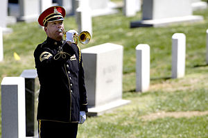 Military rites - A lone bugler plays Taps during a military funeral held at Arlington National Cemetery for former U.S. Secretary of Defense Caspar W. Weinberger.